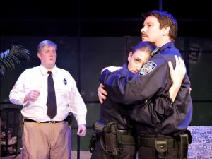 Veteran officer Bill (Garrett Prejean) comforts rookie Dawn (Kristin Shoffner) as Jeff (Patrick Hunter) watches. (Photo by Ryan Decker)