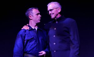 """Seth Trucks plays Winston and Peter W. Galman portrays party leader/dictator O'Brien in Outre Theatre Company's production of Andrew White's stage adaptation of """"1984."""" (Photo by Shannon Ouellette)"""