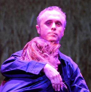 Seth Trucks as Winston comforts love interest Julia (Jennipher Murphy) in Outre's production of Andrew White's stage version of 1984. (Shannon Ouellette took the photo)