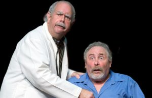 Willie Clark (Michael H. Small) and Al Lewis (Peter Librach) play a doctor and patient, respectively in a sketch within the Neil Simon play at the Broward Stage Door Theater. (Photo by George Wentzler)