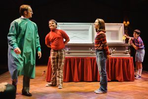 "Jason Dowies (Bruce Bechdel), Christian Collins (Christian), Camille Burkey (Small Allison) and Henry Morse (John) in ""Fun Home."" (Photo by John Barrois)"