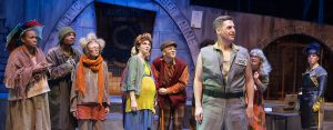 """Keith Claverie, center, leads the cast of The NOLA Project's """"Urinetown"""" at UNO's Robert Nims Theater. (Photo by John Barrois)"""