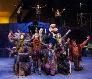"""The cast of """"Urinetown"""" including the UGC at rear. (Photo by John Barrois)"""