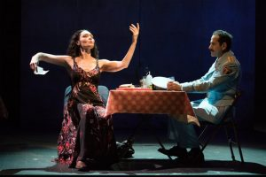 Dina (Katrina Lenk) is interested in culture and the arts as she demonstrates to Tewfiq in this scene from The Band's Visit (Photo by Ahron R. Foster)