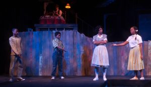 Troi Bechet as Caroline Thibodeaux and her children played by Renell Taylor, Taiya Culbertson, and Charis Gullage. (Photo by John Barrois)