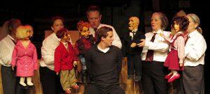Oswald (Jeffrey Roth) in custody. Behind (L-R, with dummies): Valois Mickins, Sarah Lafferty, Ben Watts,