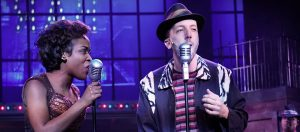 Felicia (Khadijah Rolle) and Huey Calhoun (Brian Golub) sing a duet in Slow Burn Theater's production of Memphis: The Musical. (Photo courtesy Slowburn Theatre)