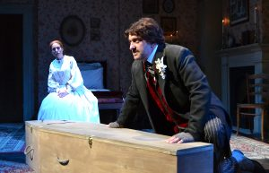 """Emily Dickinson (Margery Lowe) observes Edgar Allan Poe (Gregg Weiner) in """"Edgar and Emily"""" by Joseph McDonough. (Photo by Samantha Mighdoll)"""
