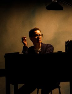 Alison as an adult (Anna Lise Jensen) contemplates her past in the dark. (Photo by Justin Namon)