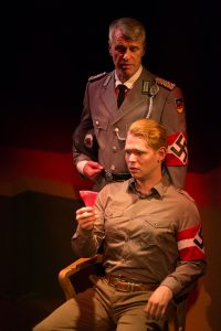 Herr Zeller (Michael Kehr, standing) shows tough love toward Rolfe Gruber (Jordan Armstrong). (Photo by Wentzler Photography)