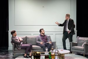 : Timothy Mark Davis, as Marc, makes a point in New City Players' explosive production of Yasmina Reza's Art. Seated, from left, are Ryan Maloney as Serge and Joey De La Rua as Yvan. (Photo courtesy of New City Players)