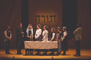 "Tevye, Golde (second and third from left) and family in ""Shabes Brokhe.""(Photo by Victor Nechay / ProperPix)"