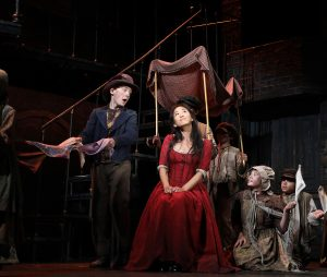 "The Artful Dodger (Gavin Swartz) and Nancy (EJ Zimmerman), along with other cast members, sing ""It's a Fine Life."" (Photo by Diane Sobolewski)"