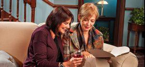 Sherri (Erika Scotti) and her friend, Ginnie (Barbara Sloan) informally converse. (Photo by George Schiavone)