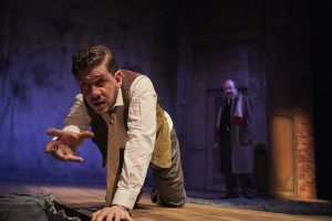 Foreground: Adam Wesley Brown (The Actor), Background: Bradley Armacost (Arthur Kipps). (Photo by Roger Mastorianni)