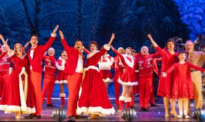"""Leading stars (left and center) Mandy Mueller (Judy Haynes) and Bryce Slocumb (Phil Wallace) and Kevin Murphy (Bob Davis) and Melissa Cotton Hunter (Betty Haynes) in """"Irving Berlin's 'White Christmas."""" (Photo by John Barrois)"""