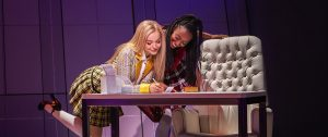 "Dove Cameron, left, and Zurin Villanueva in ""Clueless, The Musical,"" a world premiere Off-Broadway production, from The New Group, at The Pershing Square Signature Center. (Photo by Monique Carboni)"