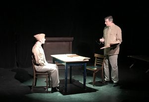 "Matthew Dalton Lynch talks with his J.A.G. defense attorney in ""The Glen."" (Photo courtesy Shelter Studios Theatre)"