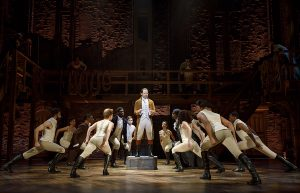 Joseph Morales as Hamilton with dancers displaying the choreography of Andy Blankenbuehler and Stephanie Klemons. (Photo by Joan Marcus)