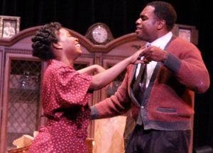 Ruth (Constance Thompson) and husband Walter Lee Younger (Michael Forest) enjoy a dance. (Photo by Peter Nakhid)