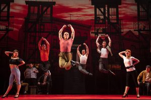 "Sergio Trujillo's choreography for ""A Bronx Tale""(foreground, l to r) Haley Hannah, Joseph Sammour, Joshua Michael Burrage, Giovanni DiGabriele, Sean Bell, Kyli Rae. (background, l to r) Robert Pieranunzi, Michael Barra, Paul Salvatoriello and Mike Backes. (Photo by Joan Marcus)"