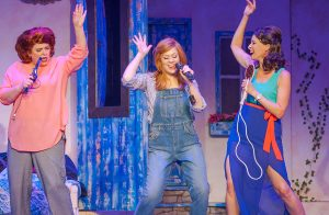 """Rosie (Lisa Picone Love), left, Donna (Ashley Smetherman Lemmler) and Tanya (Trina Breck) perform an impromptu """"Dancing Queen."""" (Photo by John Barrois)"""