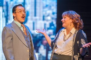 "Joe (Ryan Nocito) interacts with Violet (Megan Harms) in ""9 to 5: The Musical."" (Photo by Michael Palumbo Photorgraphy)"