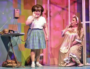 Edna Turnblad (Daniel Klingler), right, reacts as Tracy Turnblad (Adee David) is excited to receive a phone call. (Photo courtesy of Beef and Boards)