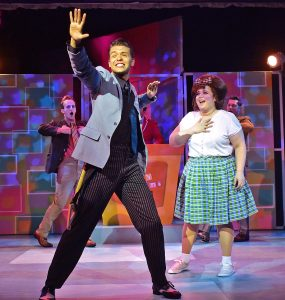 "Link Larkin (Nate Willey), front, sings ""It Takes Two"" to Tracy Turnblad (Adee David), right. (Photo courtesy of Beef and Boards)"