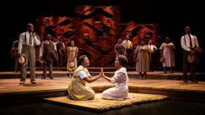 "Mariah Lyttle, left front, and Milika Cherée, right front, and the cast of ""The Color Purple."" (Photo by Jeremy Daniel)"