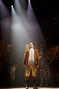 Joseph Morales, center, as Alexander Hamilton and Nik Walker, center right, as Aaron Burr. (Photo by Joan Marcus)