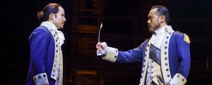 "Joseph Morales as Alexander Hamilton and Marcus Choi as George Washington in ""Hamilton."" (Photo by Joan Marcus)"
