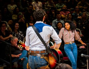Cowhand Curly McLain (Damon Daunno) facing Laurey Williams (Rebecca Naomi Jones). (Photo by Little Fang)