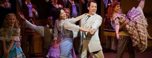 """""""Professor"""" Harold Hill (John Tartaglia) and Marian Paroo (julie Kleiner) dance, along with ensemble members of The Wick Theatre's production of The Music Man. (Photo by Amy Pasquantonio)"""