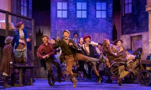 """The cast of """"Oliver!"""" kick up their heels. (Photo by John Barrois)"""