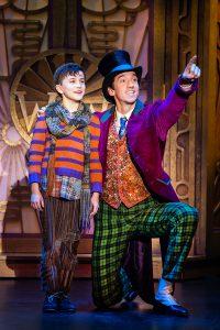 Ryan Umbarila as Charlie Bucket and Cody Garcia as Willy Wonka. (Photo by Jeremy Daniel)
