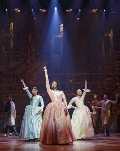 """Schuyler sisters Eliza (Phillipa Soo), left, Angelica (Renée Elise Goldsberry), center, and Peggy (Jasmine Cephas Smith) in """"Hamilton: An American Musical."""" (Photo by Joan Marcus)"""