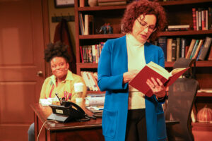 Zoe (Rachel Michelle Bryant) smiles early in the play as Professor Janine Bosco (Lisa Kay King) reads a passage aloud. (Photo by Matthew Tippins)