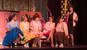 Pink Ladies gathering. (Photo courtesy Rivertown Theaters for the Performing Arts)