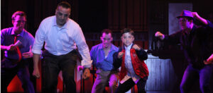 Daniel Rosenbaum, front left, as Sonny with Ashton Heathcoat as young Calogero. (Photo courtesy Broadway Palm Dinner Theater)