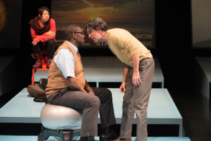 """Celeste Den, Bruce A. Young and Barret O'Brien in """"Water by the Spoonful."""" (Photo by Jenny Graham)"""