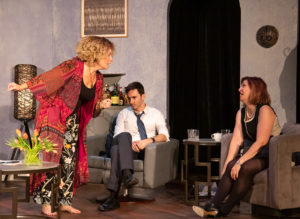 Veronica Novak (Jennifer Schemke), left, reacts at Annette Raleigh (Reagan Lincoln) as Alan Raleigh (Jake Wynne-Wilson) wishes he were elsewhere. (Photo by Joshua Frederick)