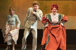 Mandy Zirkenbach, right, dances with Liam Gillen, center, and Emily Bagwill.
